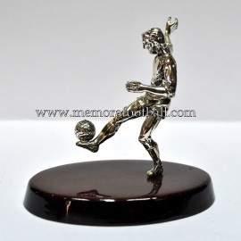 A silver figure of a footballer. Spain 1990s